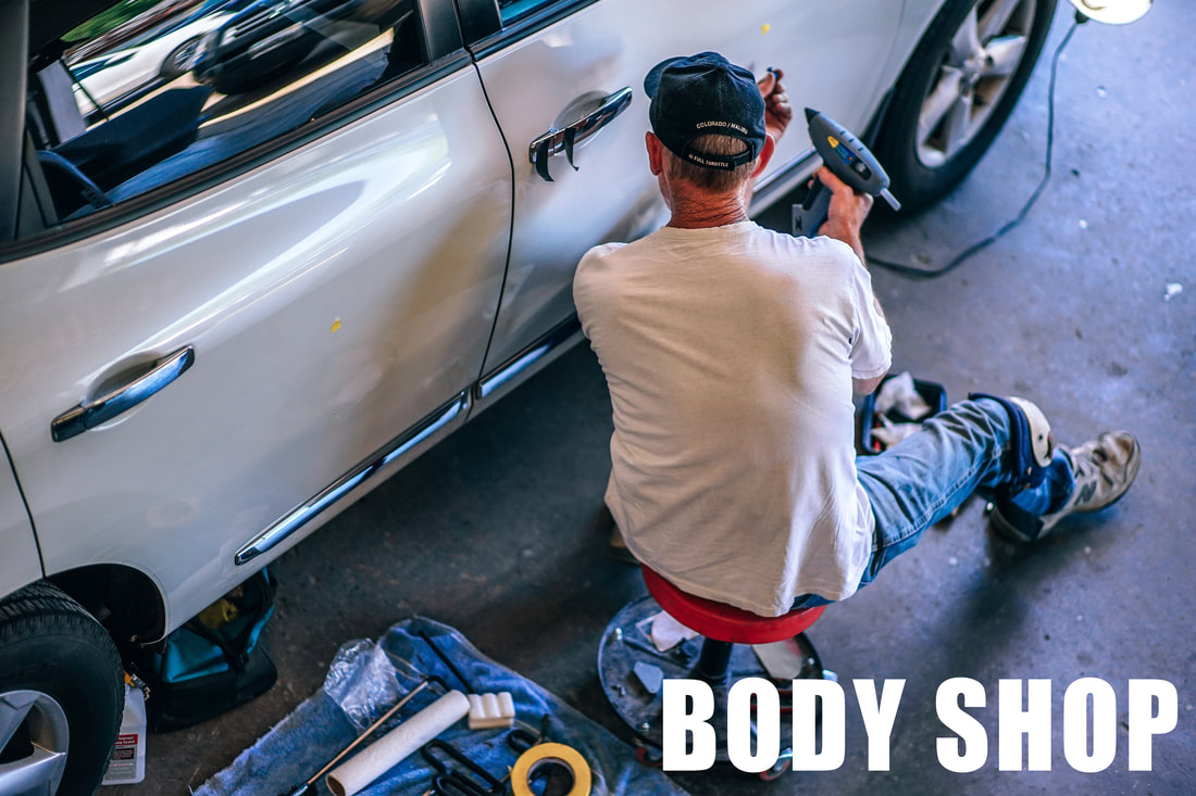 Body Shop_man_dent_removing